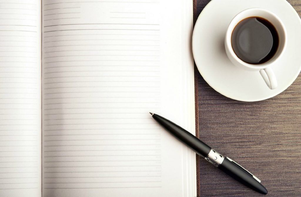 notepad pen and coffee